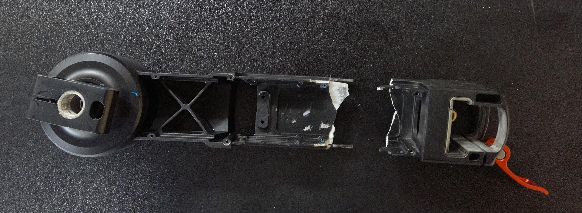 Broken Ronin M vertical arm dismantled.