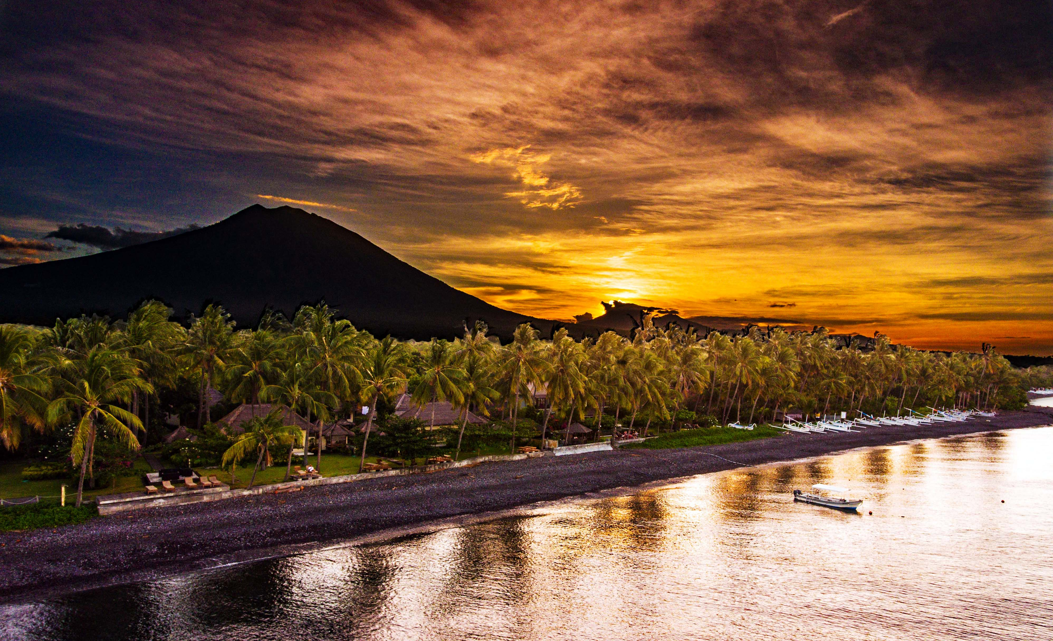 Tulumben, Bali at sunset behind Mount Agung.