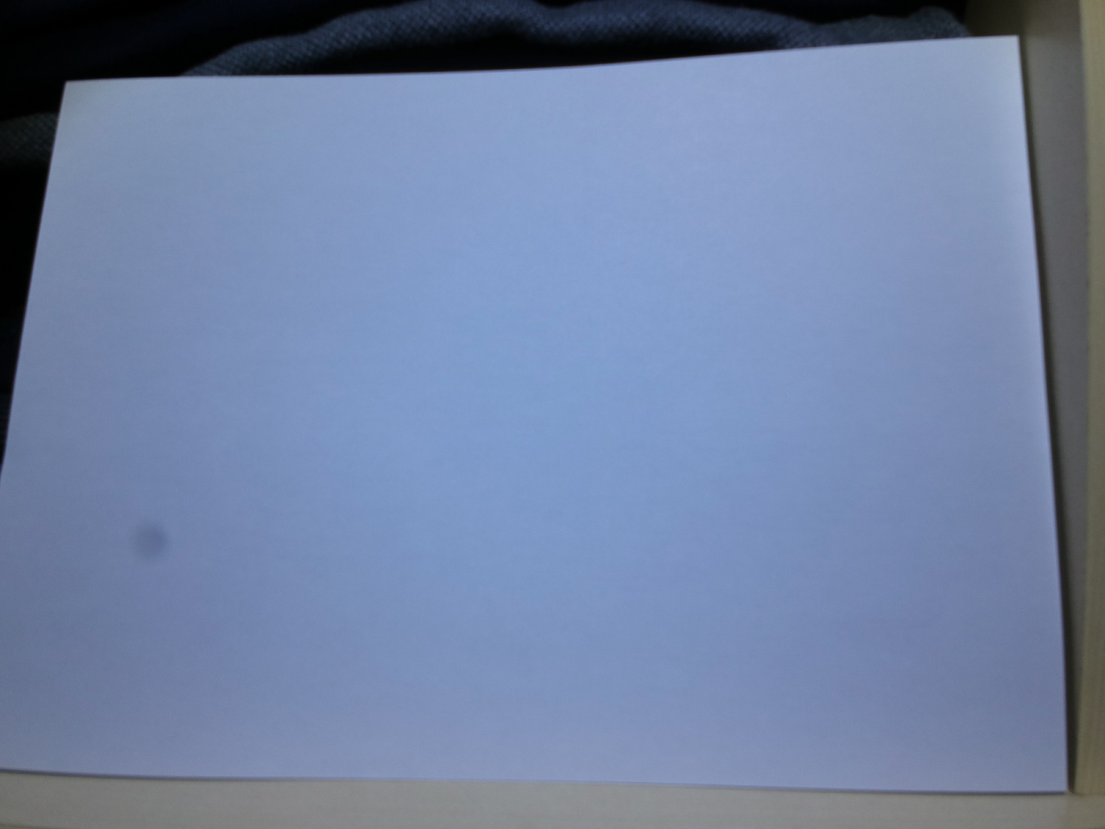 White sheet of paper, dark spot visible 2