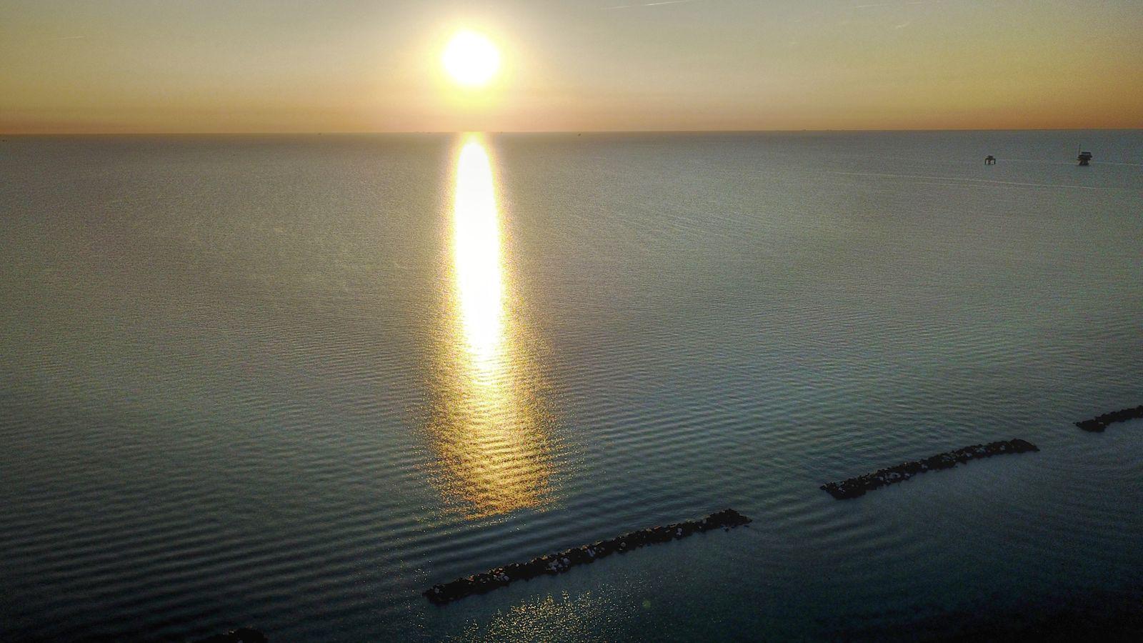 Sun rises above Adriatic Sea ...