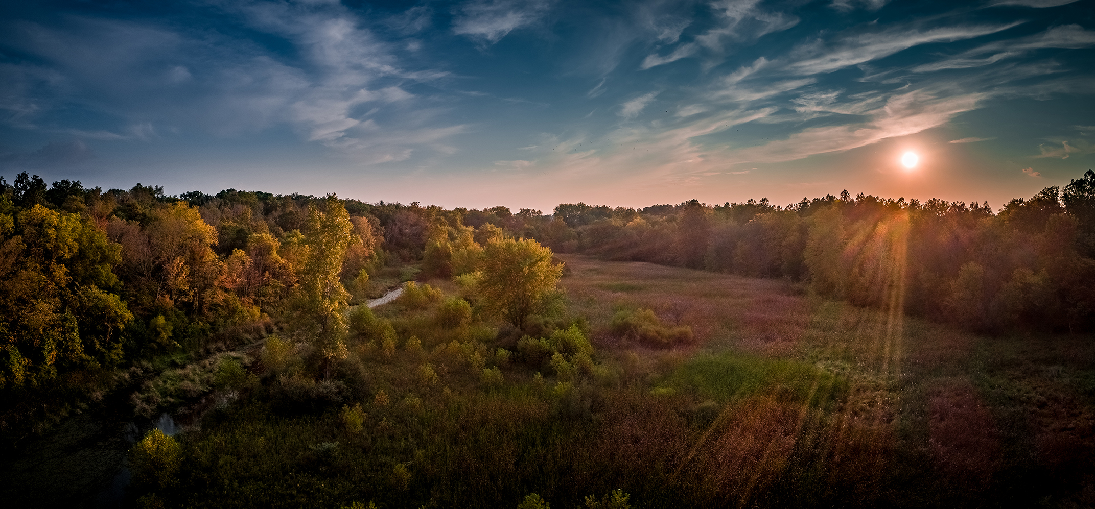 A view of the wetlands in autumn at sunset