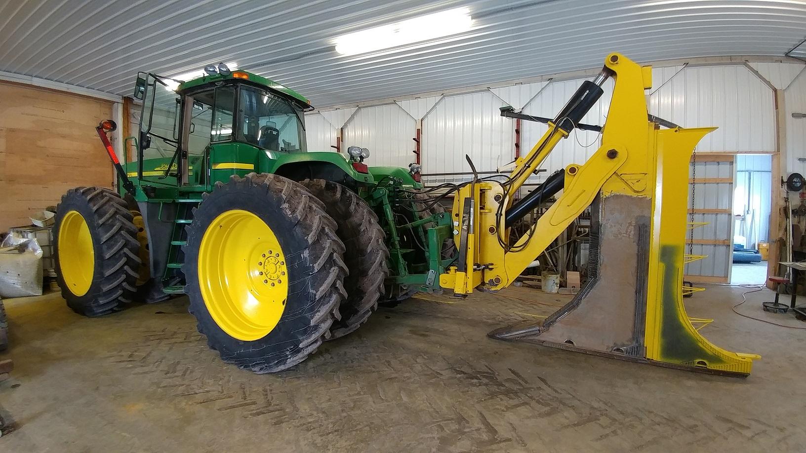 JD9220 with custom built tile plow by Split Pine Farms, Inc.